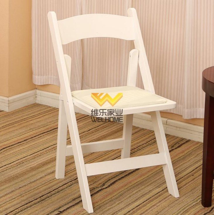 White wooden folding chair for wedding/event